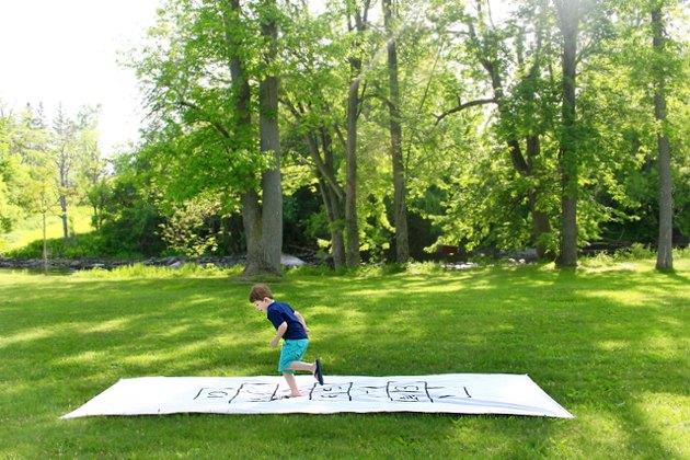 little boy playing hopscotch