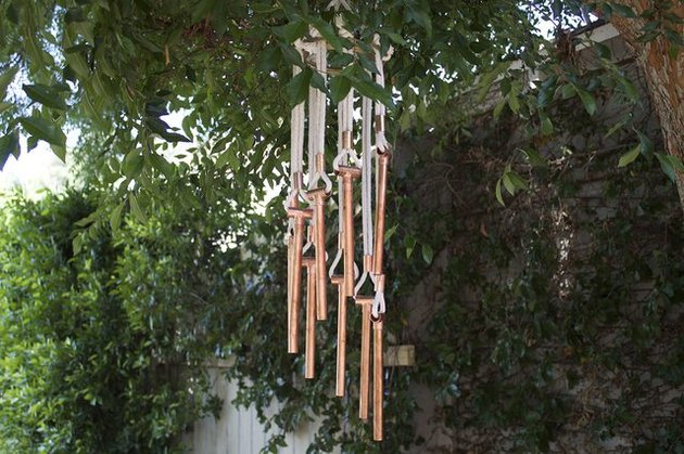 homemade wind chime in tree