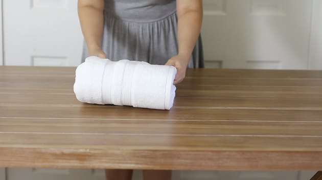 Folding towel in thirds