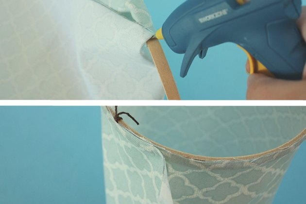 Glue the fabric to the top embroidery hoop.