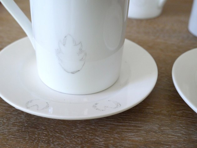 The backside of the mug with the transferred image of the tail