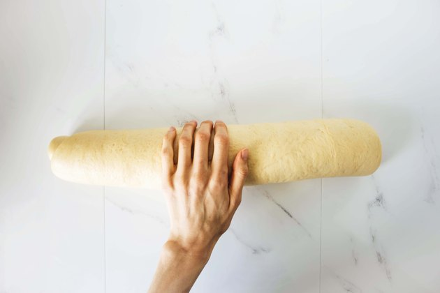 Cinnamon roll dough rolled into a tight log.