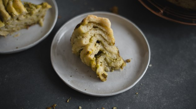 Slice the Cheesy Herb Swirl Bread to reveal gorgeous interior layers!