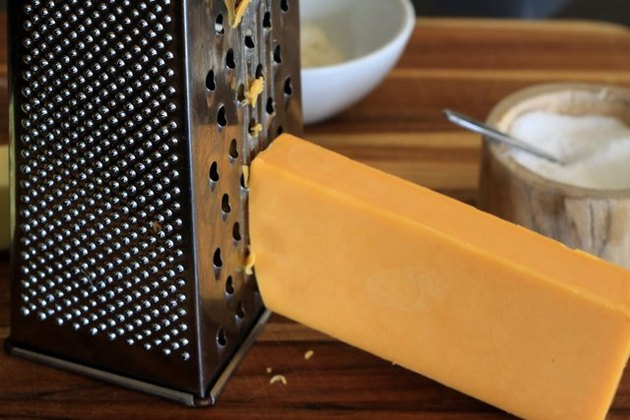 Grate the cheddar cheese.