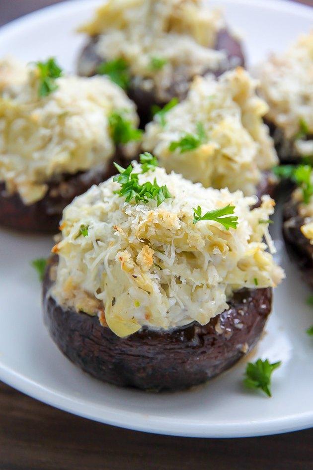 Baked mushrooms stuffed with artichoke dip.