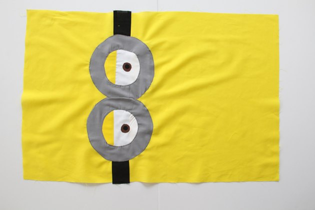 Sew goggles and eyes onto front pillowcase
