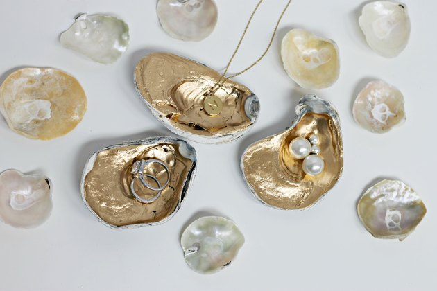 Gilded oyster shells as jewelry holders