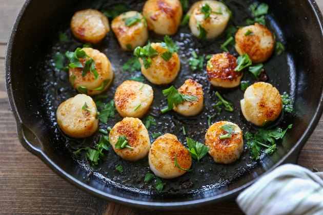 Scallops in a skillet with parlsey