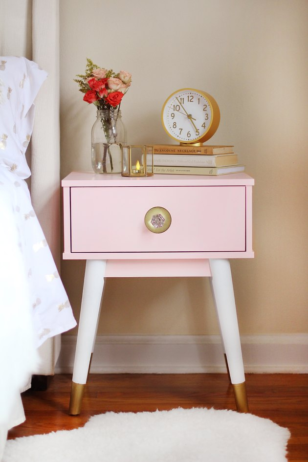 Nightstand painted blush pink with gold dipped legs