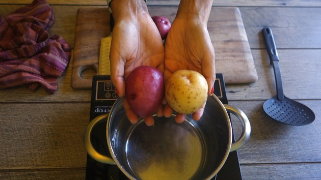 Preparing raw potatoes for freezing.