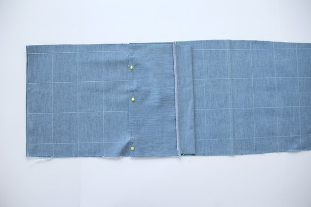 Pin pocket to one side of main pattern piece