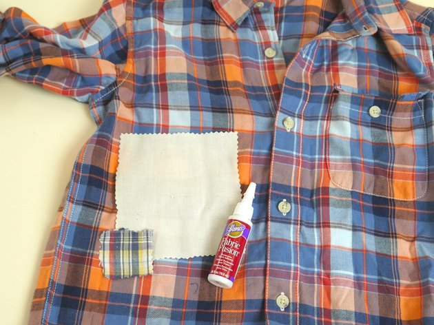 Fabric patches added to the front of the shirt with fabric glue.