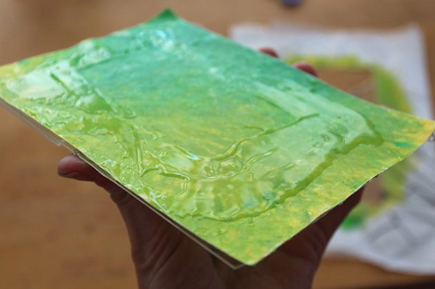 The melted crayon wax paper with glue on top of it, and glued to the acrylic frame