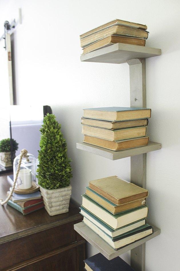Spine bookshelf mounted on wall.