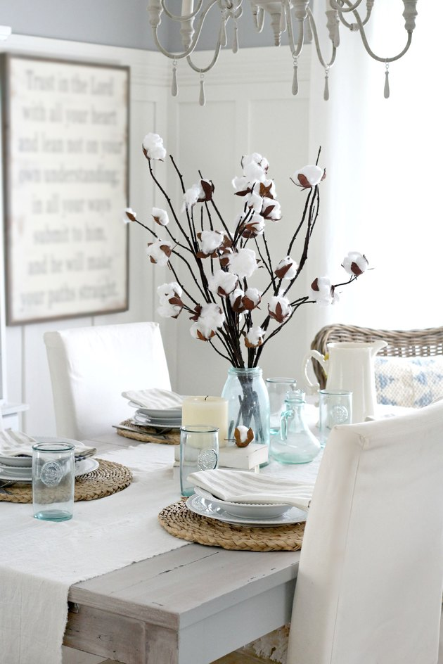 cotton branch centerpiece in middle of dining table