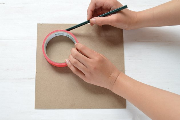 Drawing circle on cardboard