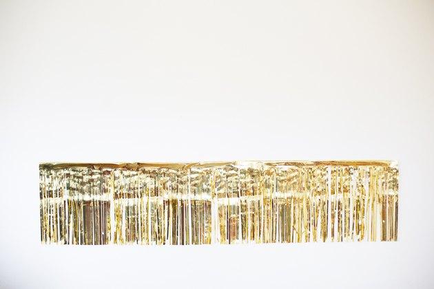 Gold fringe garland on wall