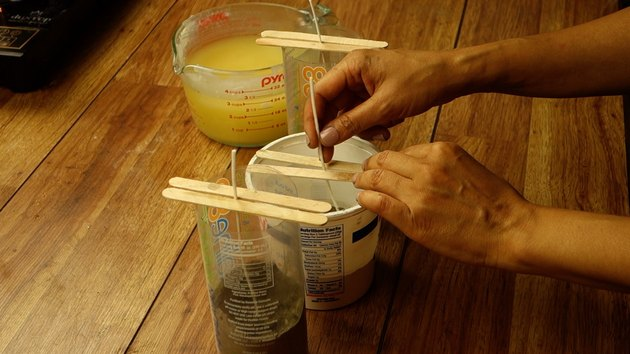 Placing candle wick on cement base for DIY candles with cement base project