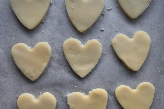 Cut heart shapes out of the cookie dough.