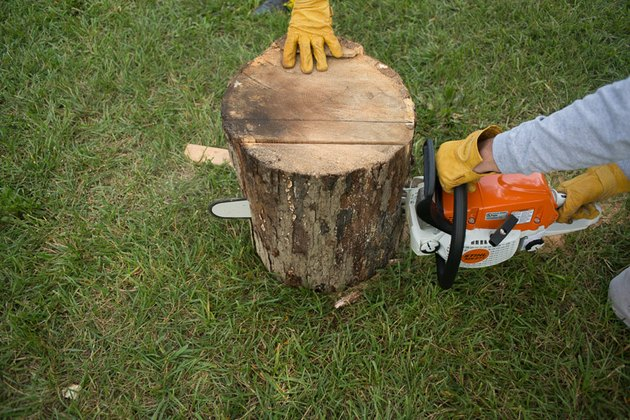 Use a chainsaw and cut downward.