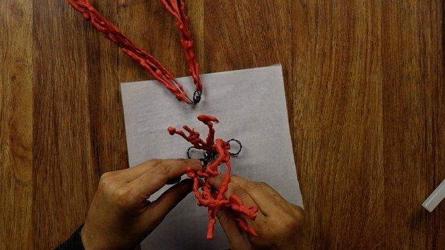 Assembling DIY faux coral sculpture.