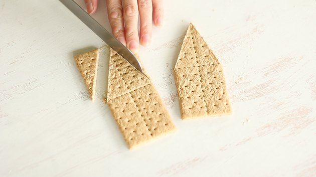 Slicing pointed ends on two crackers