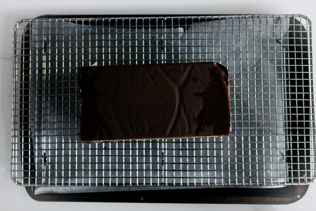 Place the cake onto a cooling rack set over a lined baking tray for no mess.