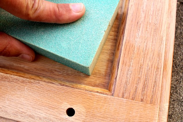 hand sand crevices | How to Paint Oak Bathroom Cabinets