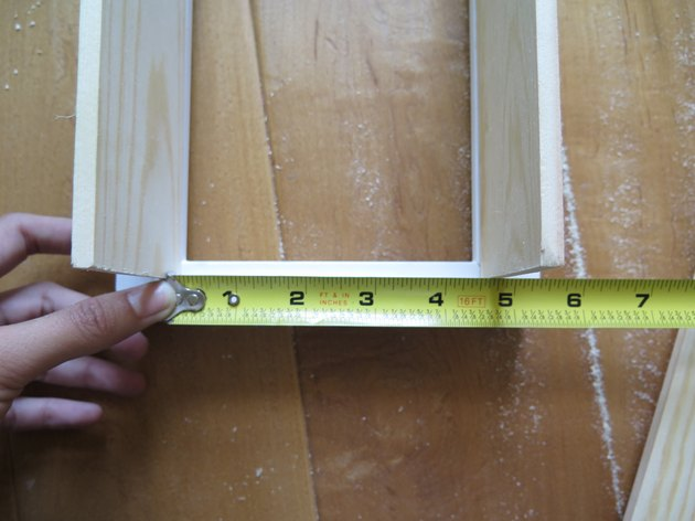 Measure the shortest side between the two long wood boards.