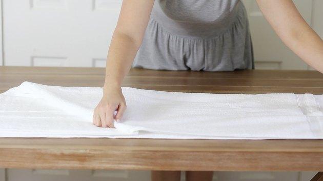 Folding towel in half