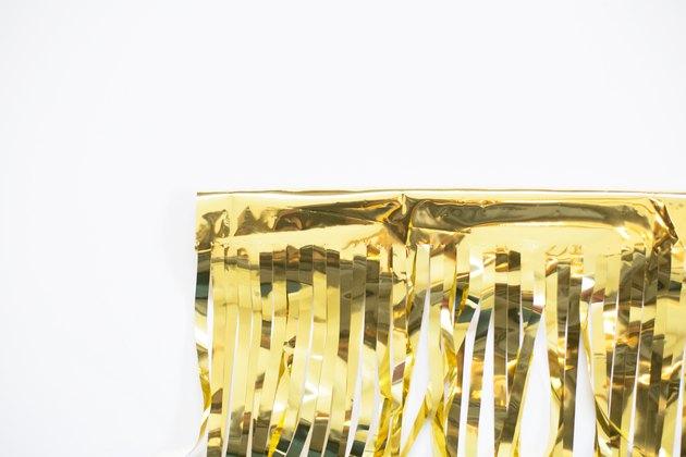 Front side of taped gold fringe garland