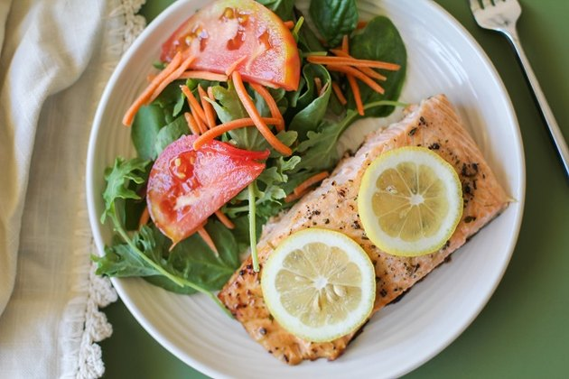 Salmon on a plate with salad