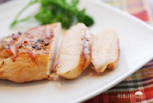 Grilled chicken breast, sliced on a plate.