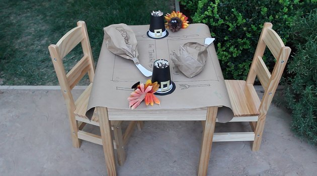 kids' thanksgiving table with butcher paper place setting