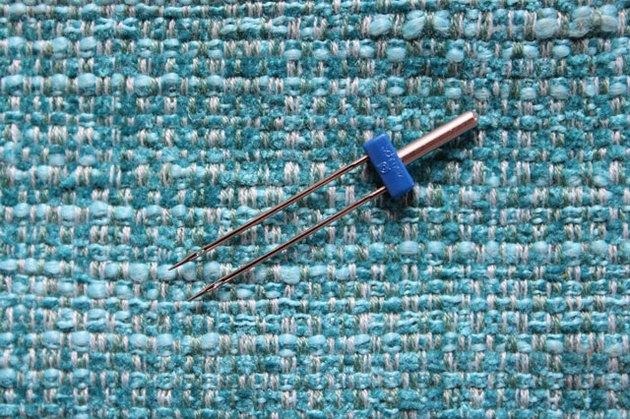 Use a double needle to hem knit fabrics.