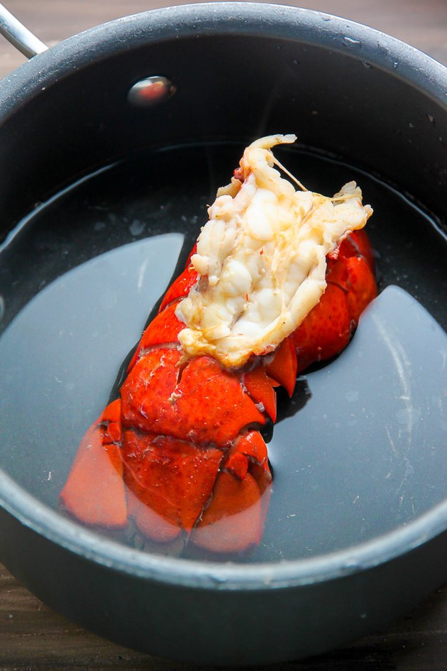 Steam the lobster tails in one inch of water until the meat is firm and the shells are bright red.