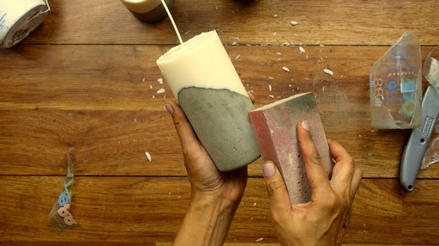 Finishing DIY candles with cement base.