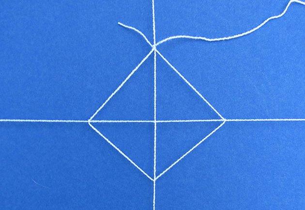 Create a diamond shape by tying knots.