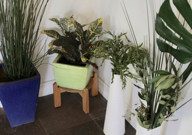 Artificial plants in containers in home.
