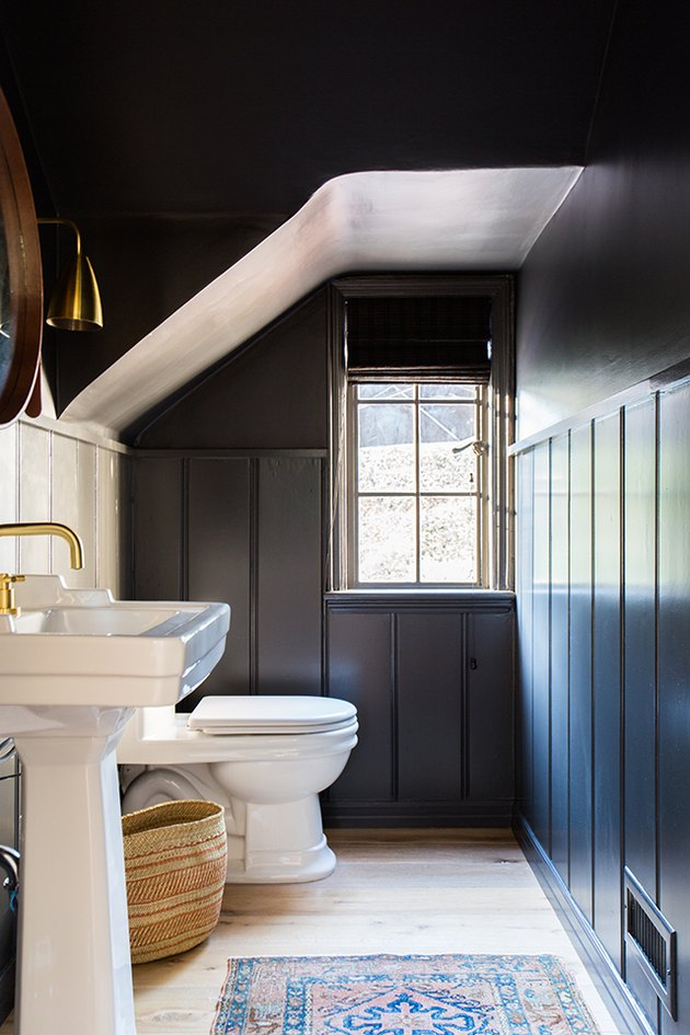 Powder room with dark walls and ceiling