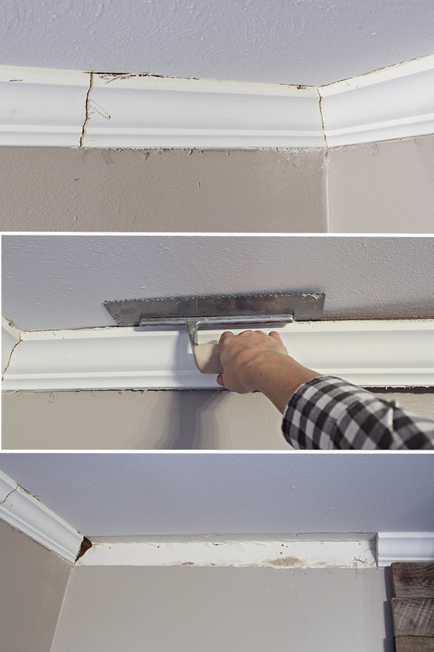 Prying loose the crown molding with a trowel