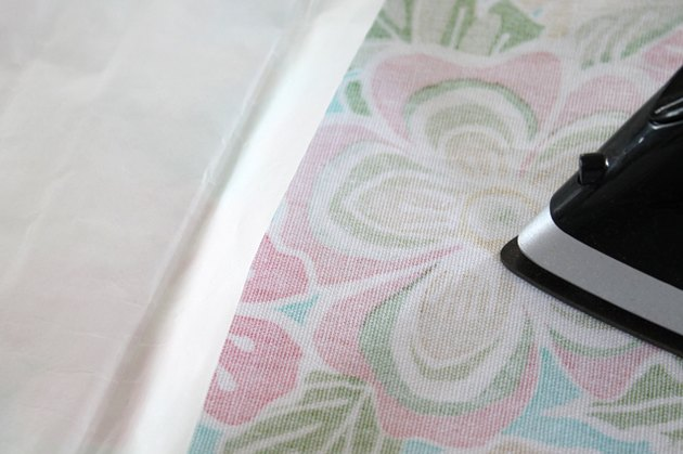 press iron-on adhesive to fabric back
