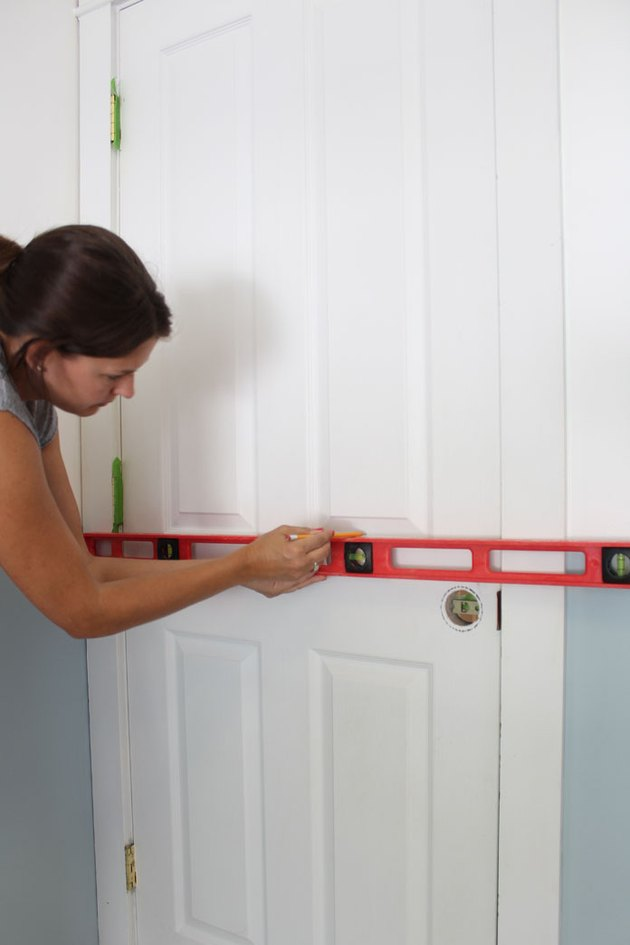 Measure and mark the interior door with a level.