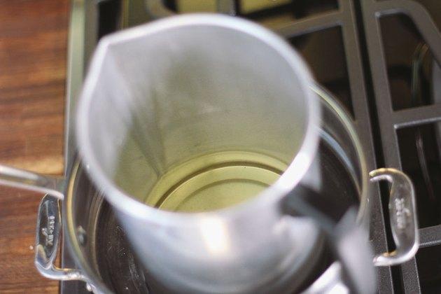 Melt soy wax in a double boiler.