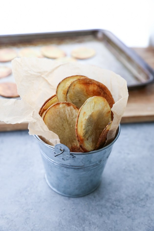 Baked potato chips in a small bucket