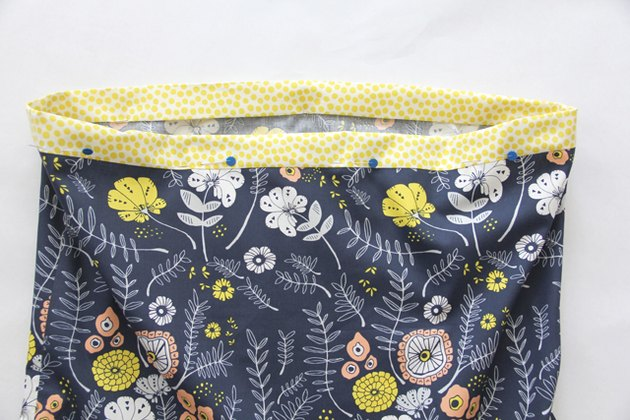 Fold waistband towards inside, pin and sew.