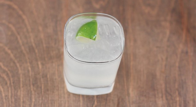 gin and tonic garnished with lime