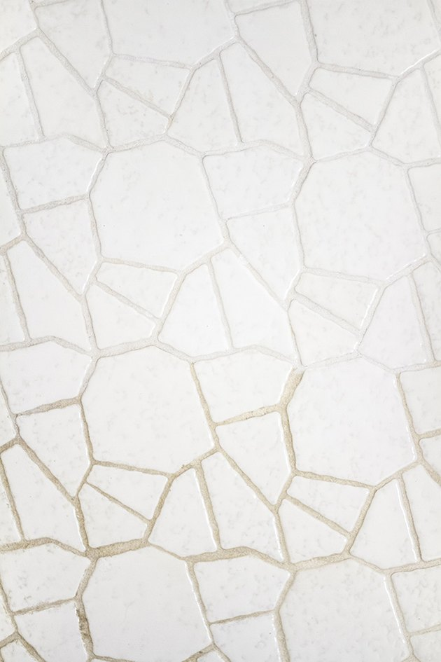 half painted grout and half unpainted grout