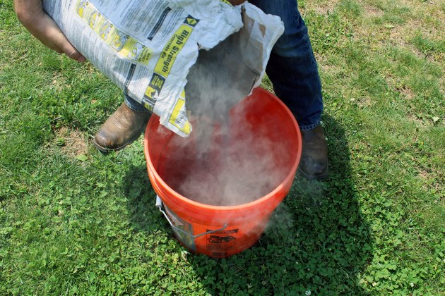 pour 1/2 bag of concrete into bucket