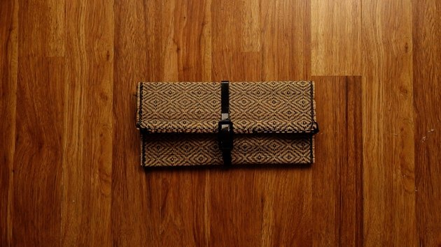 Upcycled no-sew clutch from a bamboo placemat and faux patent leather belt